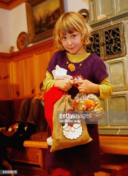 8 yearold Luisa carries her presents she received from Saint Nicolas after his visit at her family on December 6 2009 in Berchtesgaden Germany Saint...