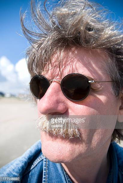 50 year-old man, grey hair, sunglasses, wide-angle portrait