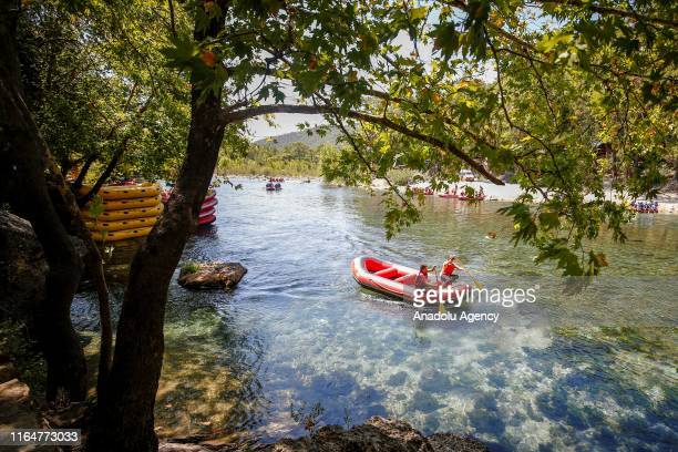 22 yearold Mihrican Armagan of Turkish National Rafting Team rows on a boat on a river in Antalya Turkey on August 29 2019 Mihrican Armagan is called...