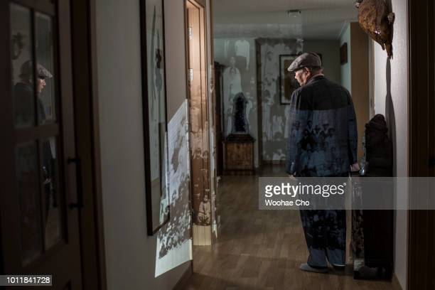 82 yearold Min Dongseong shows the pictures he has kept since he fled in his apartment in Incheon on July 18 2018 in South Korea Min is from...