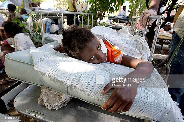 10 yearold Naika Snyder has her bed inclined by rocks in a makeshift clinic outside a PortauPrince Haiti hospital on Saturday January 16 2010