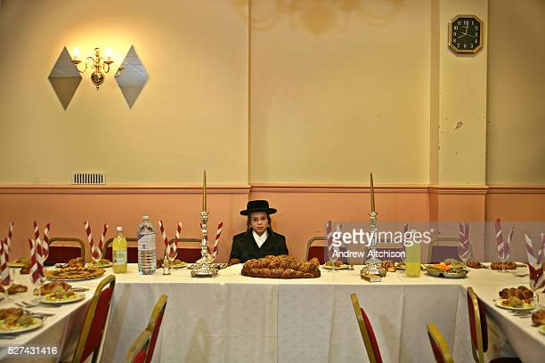 A 13 yearold Orthodox Jewish boy sits waiting for his Bar Mitzvah to begin in a Parces hall Stamford Hill The Bar Mitzvah signals the coming of age...