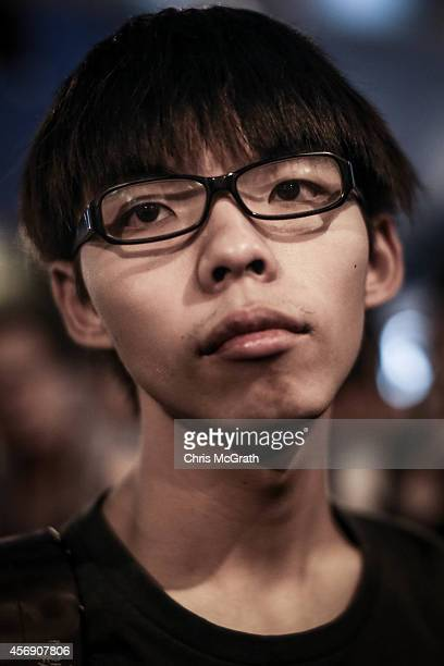 Year-old student leader Joshua Wong looks on after giving a speech to protesters outside Hong Kong's Government complex on October 9, 2014 in Hong...