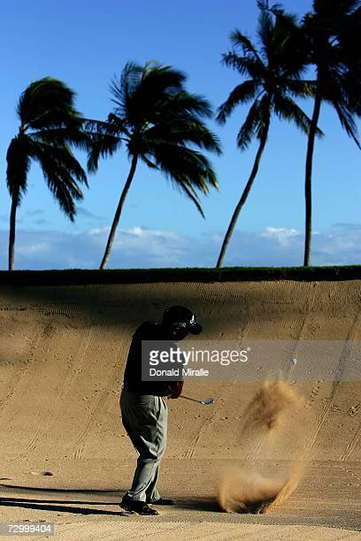 16 yearold Tadd Fujikawa of Honolulu hits out of the 17th green bunker during the final round of the Sony Open on January 14 2007 at Waialae Country...