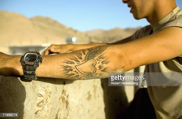 Year-old US Army soldier displays his tattoo at Forward Operating Base Mizan in Zabul Province, Afghanistan September 14, 2006. The soldiers are from...