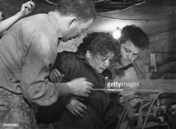 A 75 yearold woman is helped into Tunnel 57 through which 57 East Berlin citizens escaped to the Western sector of the city on 3rd and 4th October...