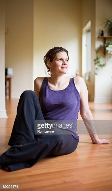 40 year-old woman practicing yoga in a studio