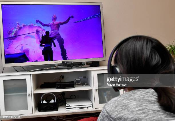 15 yearold Yasmin the photographer's daughter plays Fortnite featuring Travis Scott Presents Astronomical on April 23 2020 in Los Angeles United...