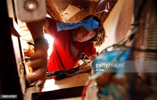 17–year–old Zac Sunderland helps his father Laurence Sunderland repair the bulkhead of his 36–foot sailboat 'Intrepid' in Puerto Vallarta Mexico Zac...