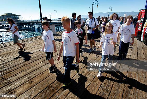 12–year–old Zach Bonner center of Tampa Fla arrives in a humble fashion at the Santa Monica pier finishing the final leg of his nearly...