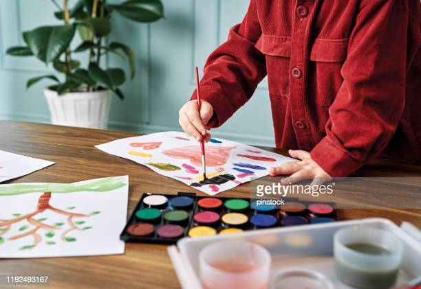2-3 years child painting with watercolor at home. - one boy only stock pictures, royalty-free photos & images