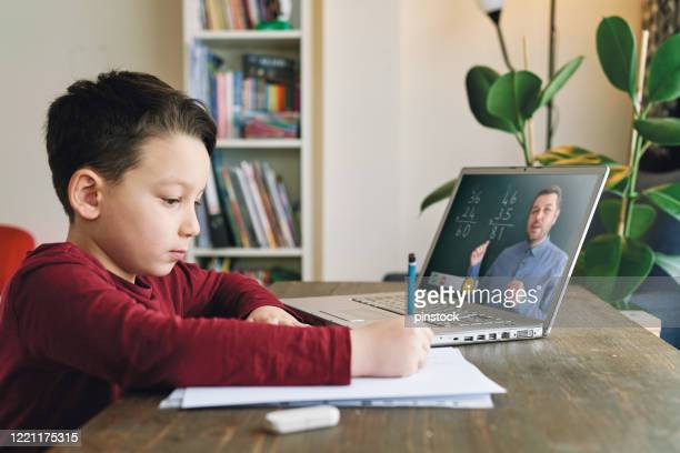 6-7 years cute child learning mathematics from computer. homeschooling concept. - 6 7 years stock pictures, royalty-free photos & images