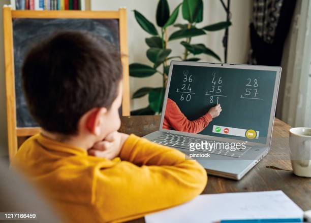 6-7 years cute child learning mathematics from computer. - online class stock pictures, royalty-free photos & images