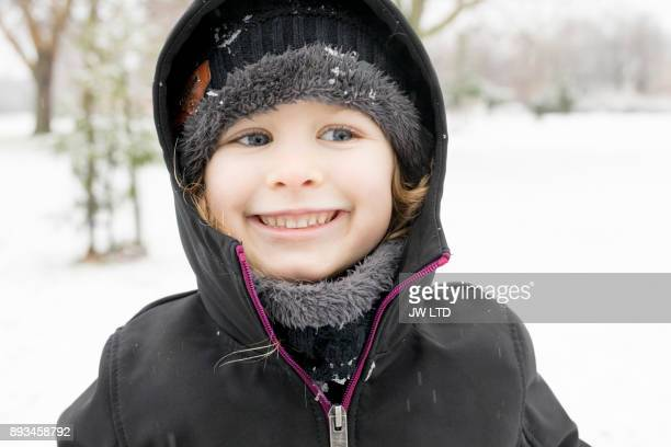4-5 years girl portrait in winter, outdoors, snowing, happy, joyful