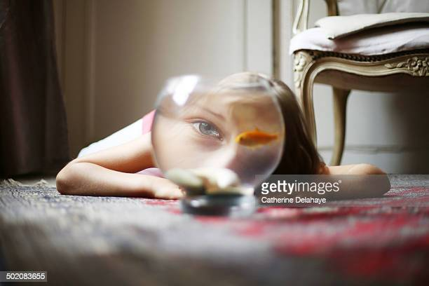 a 7 years girl with her goldfish - goldfish stock pictures, royalty-free photos & images