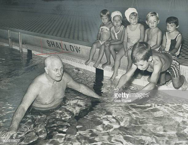 40 years in the swim Gus Ryder 71 celebrates 40th anniversary of his Lakeshore Swim Club Sunday Ryder who specializes in coaching yougsters is shown...