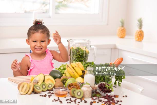 2-3 years old assistant in the kitchen. making juices. - mint plant family stock pictures, royalty-free photos & images
