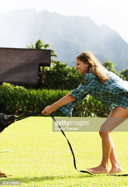 43 years old beach natural women look, playing with a dog