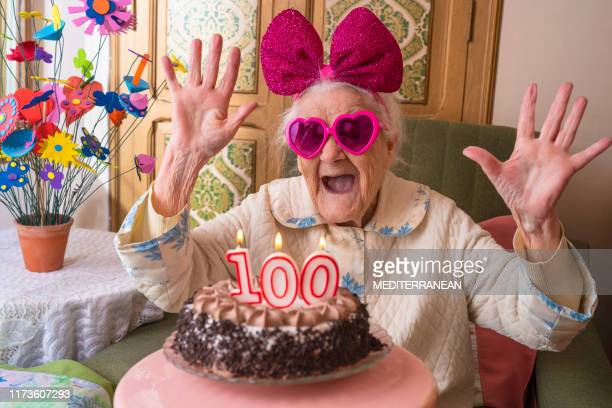 100 years old birthday cake to old woman - humor imagens e fotografias de stock