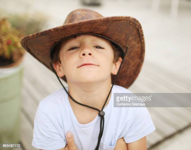 a 6 years old biy wearing a cowboy hat - 6 7 years stock pictures, royalty-free photos & images