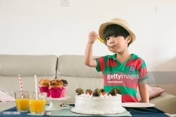 4 years old boy and birthday cake.