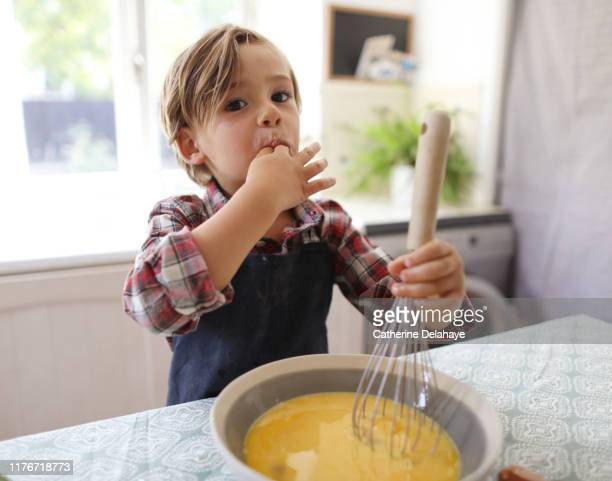 a 4 years old boy cooking at home - 4 5 years stock pictures, royalty-free photos & images