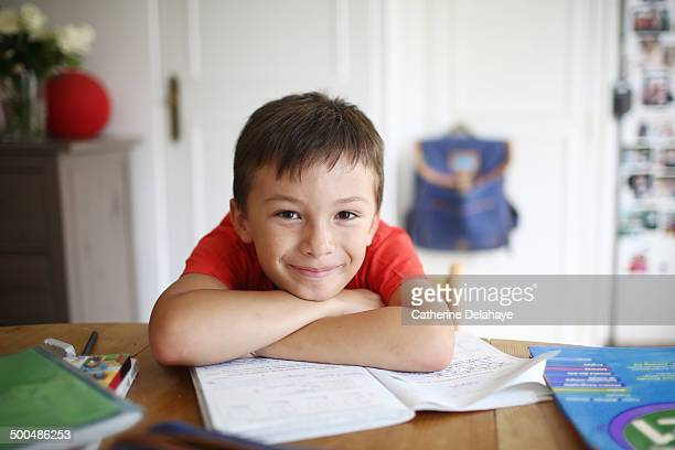 a 7 years old boy doing his homework - 6 7 years stock pictures, royalty-free photos & images