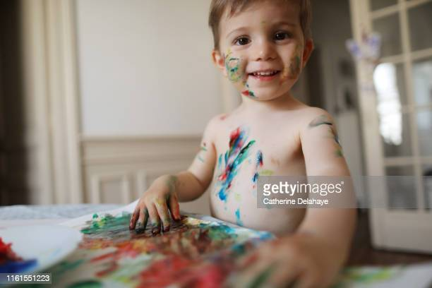 a 2 years old boy doing painting at home - art and craft stock pictures, royalty-free photos & images