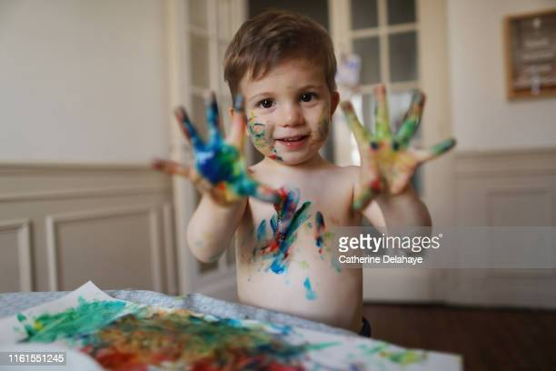 a 2 years old boy doing painting at home - 2 3 years stock pictures, royalty-free photos & images