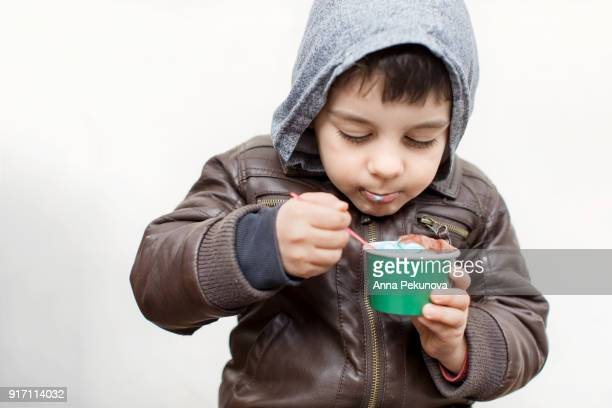 4 years old boy eating icecream