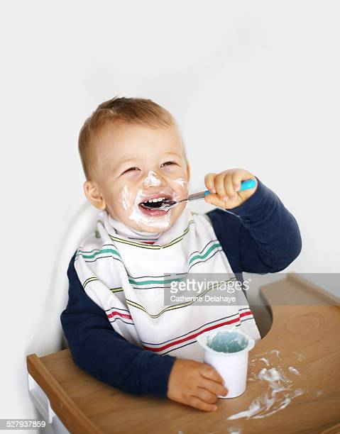 A 2 years old boy eating