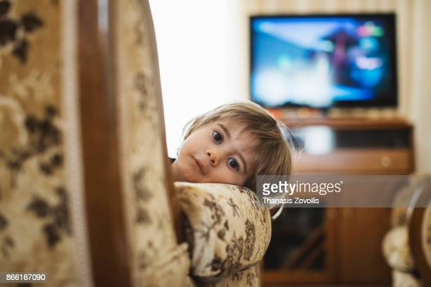 2 years old boy in front of a tv