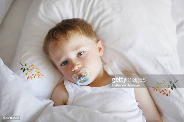 a 3 years old boy in his bed - 2 3 years stock pictures, royalty-free photos & images
