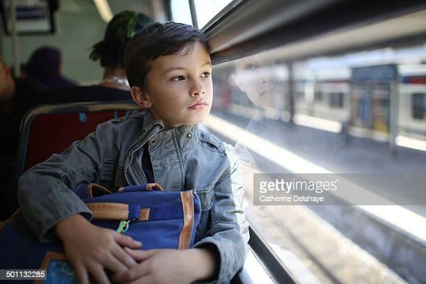 a 8 years old boy in public transport - trasporto pubblico foto e immagini stock