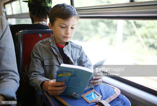 a 8 years old boy in public transport - 6 7 years stock pictures, royalty-free photos & images