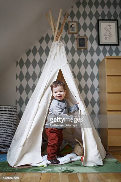 A 2 years old boy playing in his bedroom