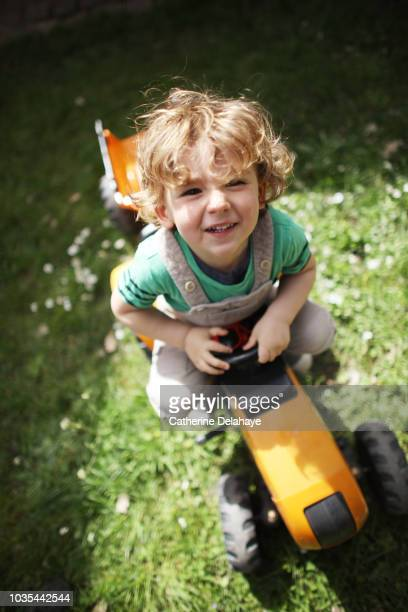 a 3 years old boy playing in the garden - 2 3 years stock pictures, royalty-free photos & images