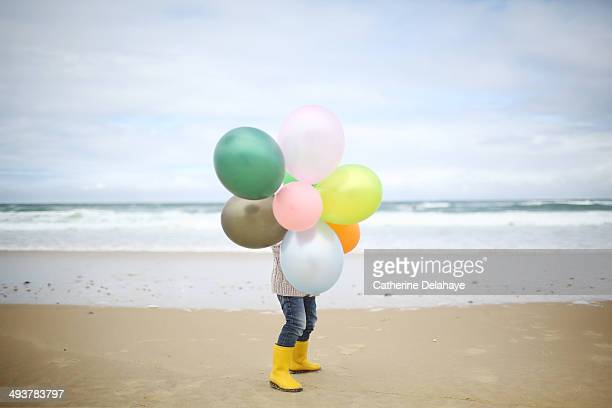 a 3 years old boy playing on the beach - delahaye stock photos and pictures