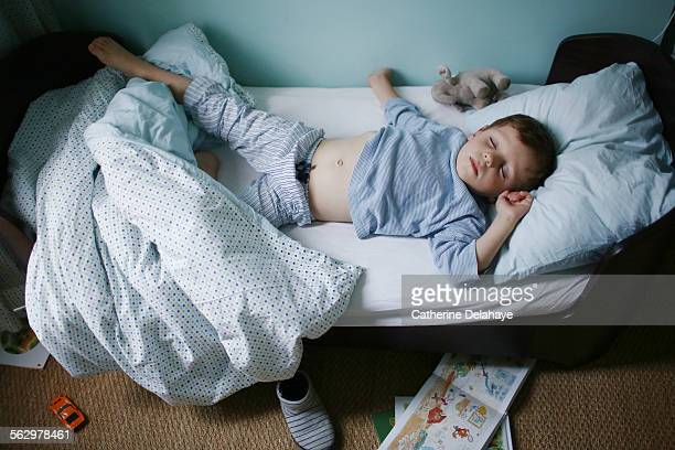 a 4 years old boy sleeping in his bed - 4 5 years stock pictures, royalty-free photos & images