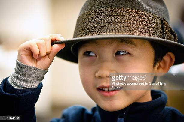5 years old boy with fedora hat