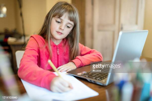 8 years old child girl studying from home - 8 9 years stock pictures, royalty-free photos & images