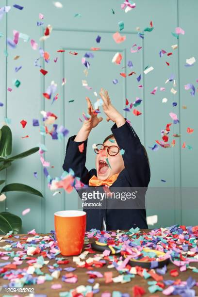 2-3 years old child wearing a suit like a businessman and he work in his office table. he celebrating his success. - adult imitation stock pictures, royalty-free photos & images