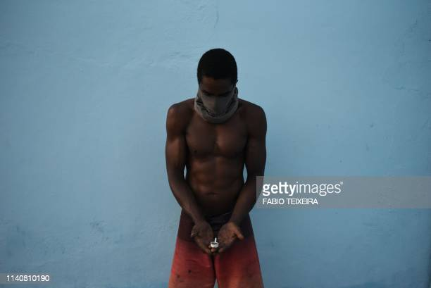 30 years old crack addict JP holds a crack pipe in his hands in the Sem Terra favela in Complexo da Mare Rio de Janeiro on April 28 2019