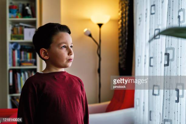 6-7 years old cute child at home for social distancing. he is boring but necessary for protection from illness. - 6 7 years stock pictures, royalty-free photos & images
