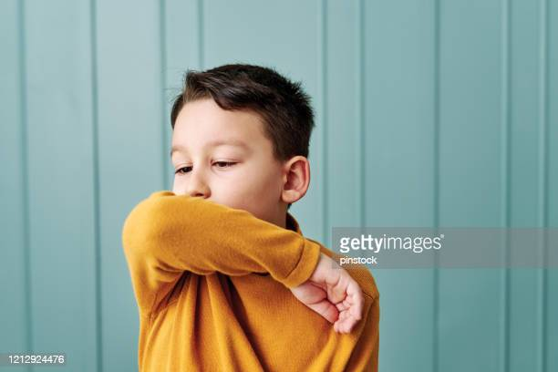 6-7 years old cute child wearing surgical mask. - one boy only stock pictures, royalty-free photos & images