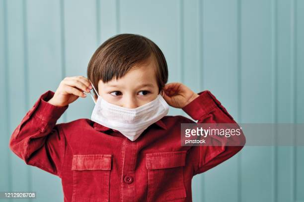 2-3 years old cute child wearing surgical mask. - 2 3 years stock pictures, royalty-free photos & images