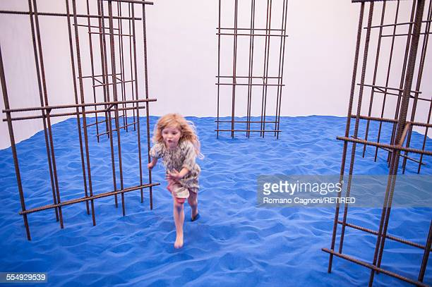 4 years old Euphemia Baker plays on the installation by artist Flaka Haliti in the Kosovo Pavilion at the Arsenale Venice Biennale May 2015