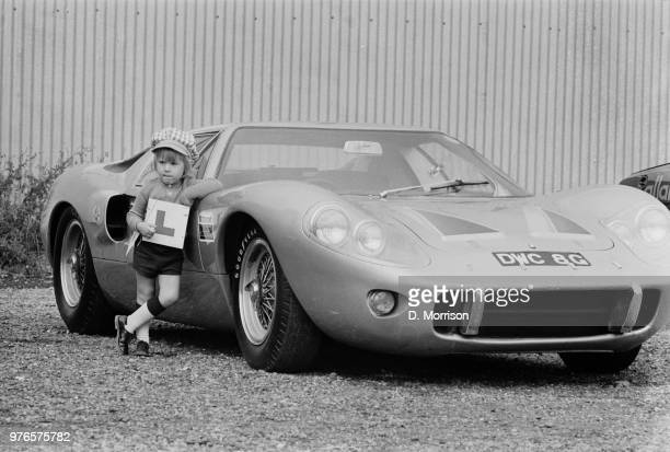 2 years old Gary Wolfe standing next to a Ford GT40 Mk III at the Crystal Palace Junior Driving School London UK 17th September 1973