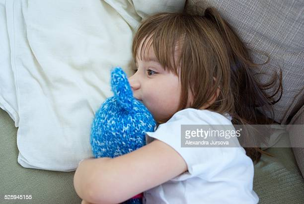 3 years old girl and her teddy bear