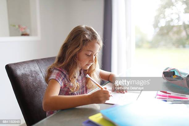 A 7 years old girl doing her homework